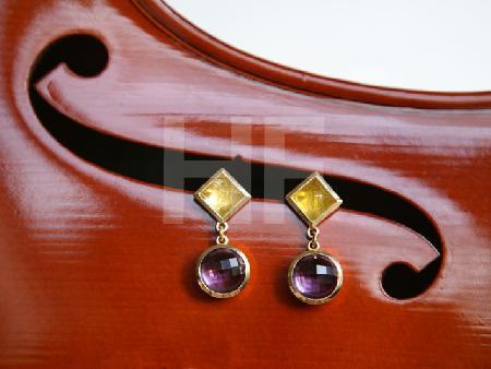 Ohrringe auf Cello